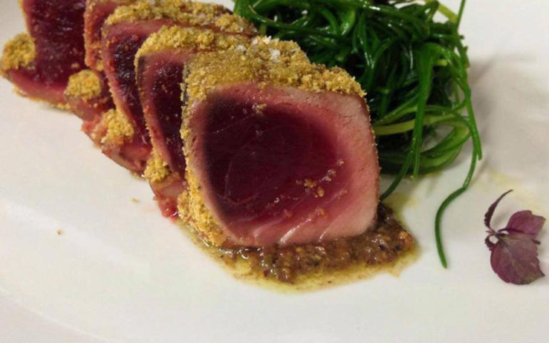 Tuna in a crust of Bronte pistachios on a bed of eggplant purée flavored with mint